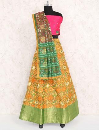 Orange hued semi stitched cotton silk lehenga choli