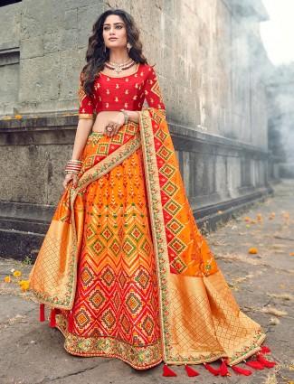 Orange silk designer lehenga choli for reception and wedding