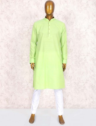 Parrot green colored cotton fabric kurta suit