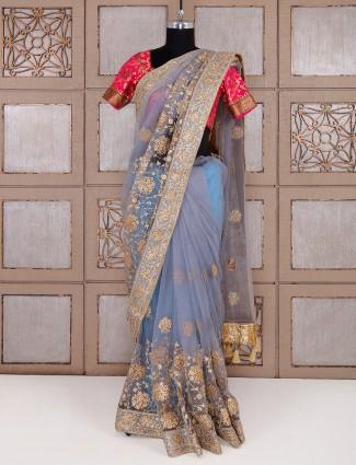 Party wear grey net fabric saree