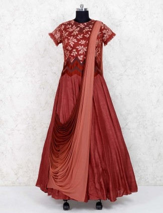 Party wear maroon hued net fabric gown