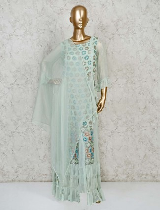 Pastel green colored georgette sharara suit with ruffle sleeves