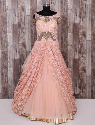Peach color designer classic net gown