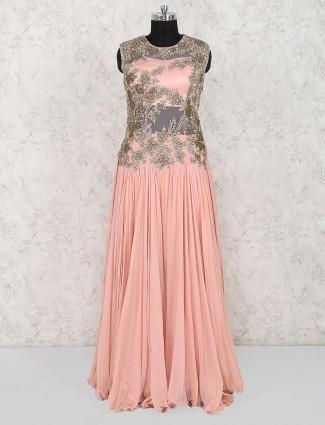 Peach color designer georgette gown