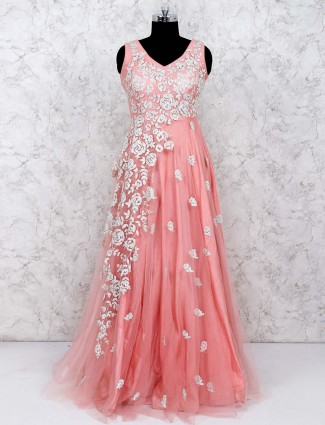 Peach color gown in net fabric
