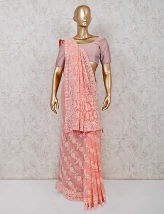 Peach colored lucknowi saree in georgette