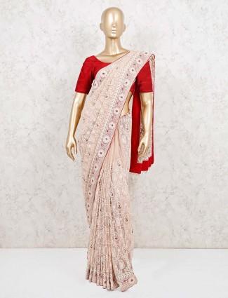 Peach designer saree in georgette for wedding party
