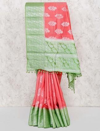 Peach hue colored semi silk fabric saree