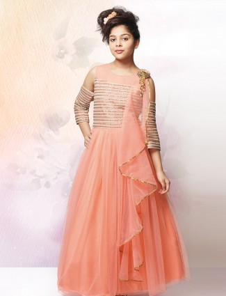 Peach hue net fabric gown for festive occasion