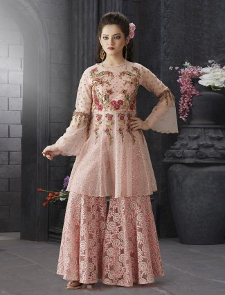 Peach hue net wedding punjabi sharara suit