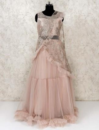 Peach hue party wear net gown
