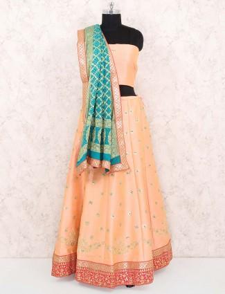 Peach hue raw silk festive semi stitched lehenga choli