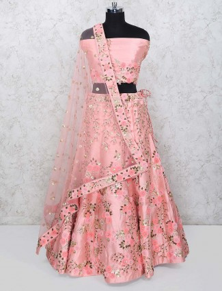Peach hue semi stitched lehenga choli in raw silk