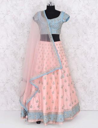 Peach hued designer silk lehenga choli