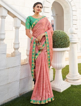 Peach jute saree with the embroidered green blouse piece