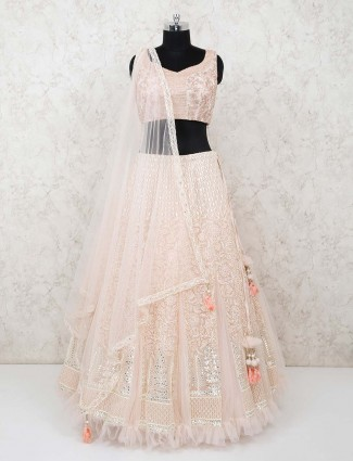 Peach net wedding function designer lehenga choli