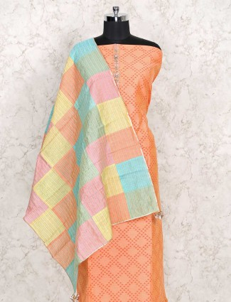 Peach printed dress material in cotton