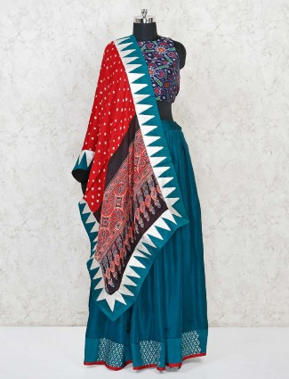Peacock blue silk lehenga with patola blouse