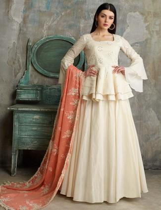 Peplum style cream hue cotton silk lehenga cum salwar suit