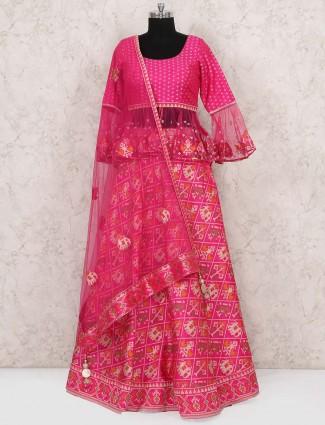 Peplum style magenta hue patola silk wedding lehenga choli