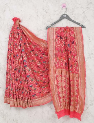 Pink colored bandhej saree for wedding function