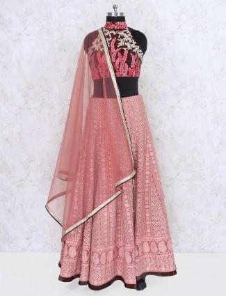 Pink colored wedding wear georgette lehenga choli