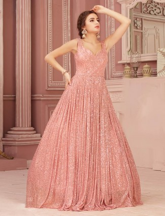 Pink gown in net with sequins work