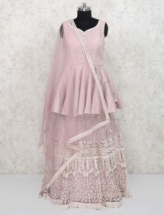 Pink hue peplum style tissue silk lehenga choli