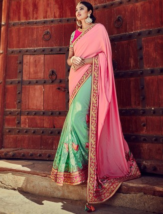 Pink sea green net silk half and half saree