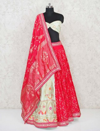 Pista and magenta semi stitched half and half lehenga choli in banarasi silk