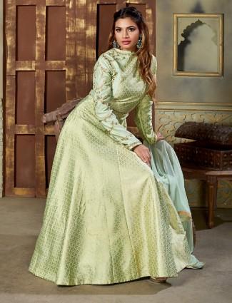 Pista green color silk fabric anarkali suit