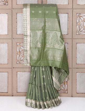 Pista green color silk fabric saree for party function