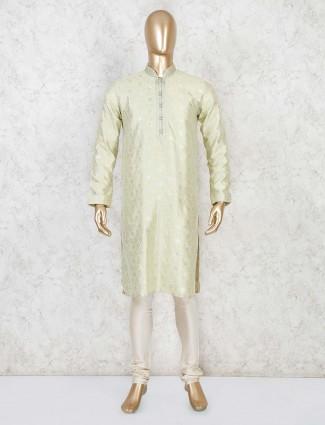 Pista green hue full sleeves kurta suit for festive