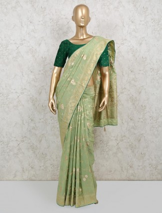 Pista green latest saree in dola silk for wedding