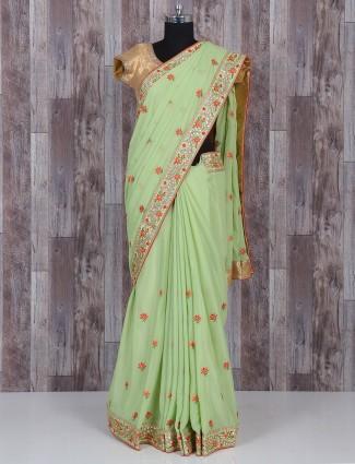 Pista green marble chiffon saree