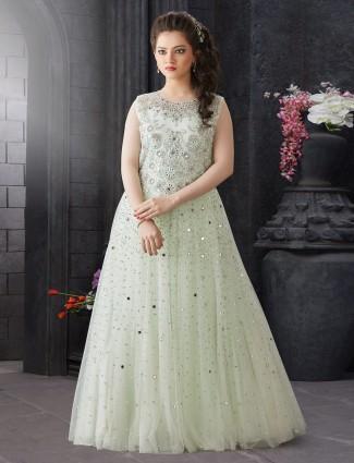 Pista green net fabric floor length gown