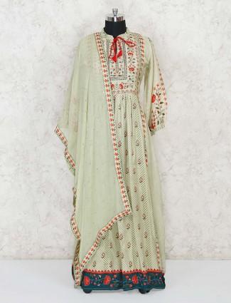 Pista green printed anarkali suit with zari work in cotton silk