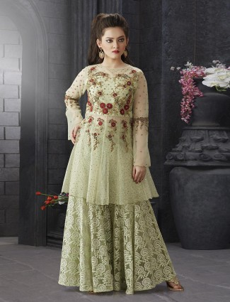 Pista green punjabi net fabric sharara suit