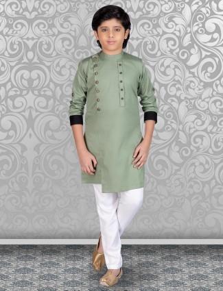 Pista  green solid cotton festive kurta suit