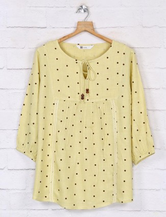 Polka dot tops design in yellow