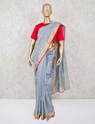 Powder blue handloom cotton saree with readymade red blouse