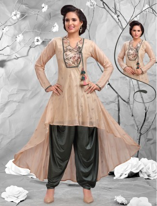 Pretty beige color dhoti suit.