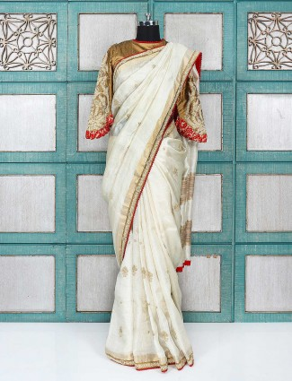 Pretty cream color wedding wear saree with ready made blouse
