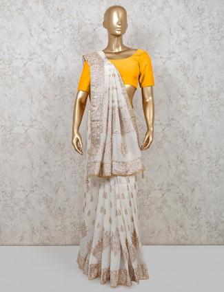 Pretty cream dola silk saree for reception