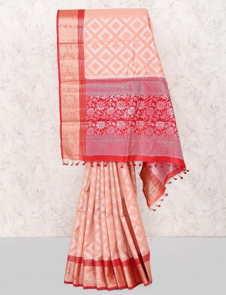 Pretty peach colored semi silk fabric saree
