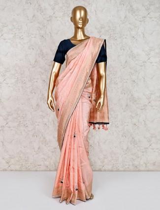 Pretty peach festive saree in satin