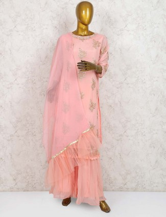 Pretty peach hue georgette sharara suit