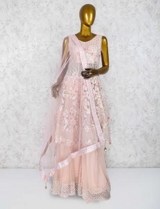 Pretty peach net fabric punjabi palazzo suit