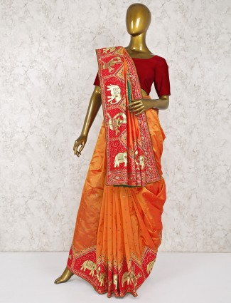 Pretty orange colored wedding silk saree
