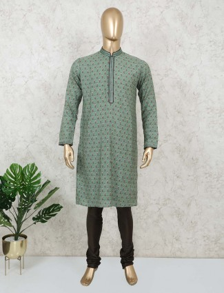 Printed green cotton kurta suit festive wear
